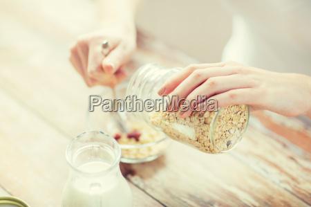 close up of woman eating muesli