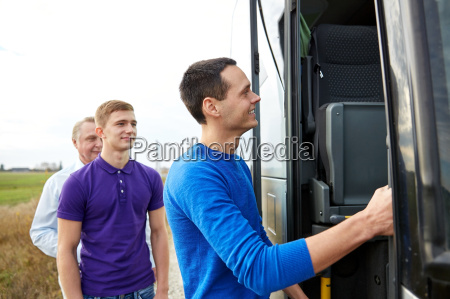 group of happy male passengers boarding