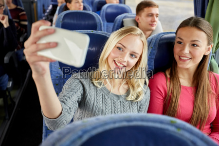 women taking selfie by smartphone in