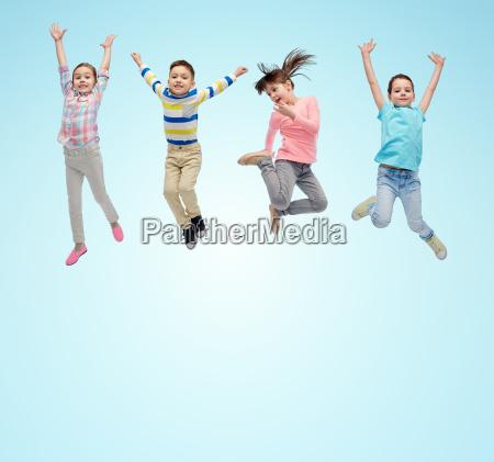happy little children jumping in air