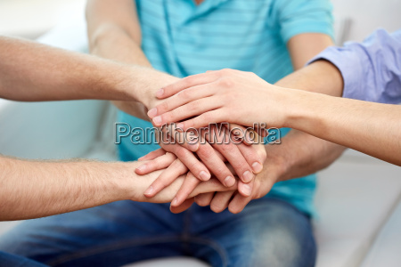 close up of friends connecting hands