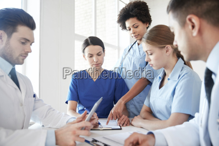 group of doctors meeting at hospital
