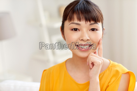 happy asian young woman at home