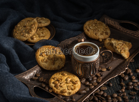 black coffee with cookies in a