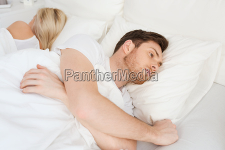 young man suffering from insomnia