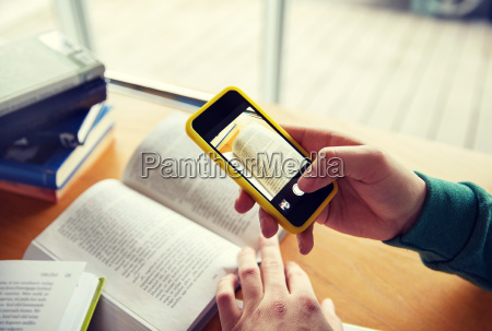 student hands with smartphone making cheat