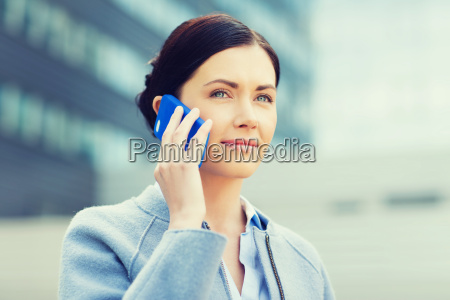 young smiling businesswoman calling on smartphone