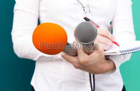 female reporter or journalist at press