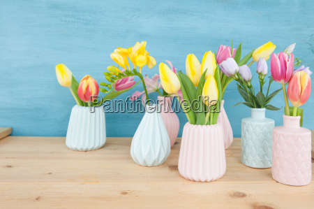 colorful spring flowers in small vases