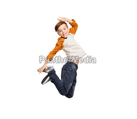 happy smiling boy jumping in air