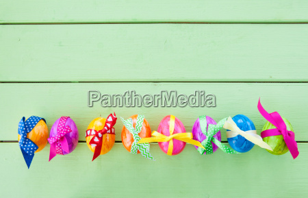 colorful easter eggs with bows