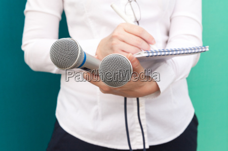 female journalist or reporter at news