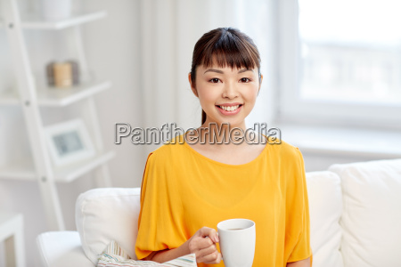 happy asian woman drinking from tea