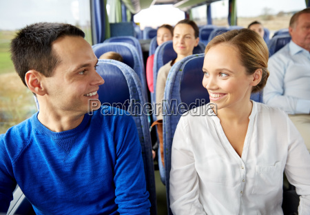 group of happy passengers in travel