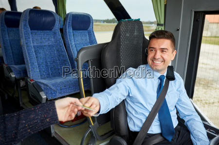 bus driver taking ticket or card