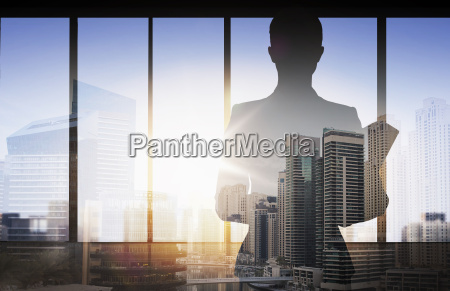 silhouette of businesswoman with folder over