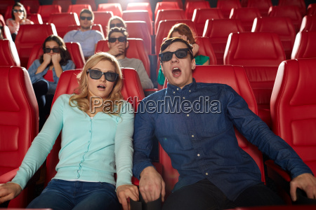 friends watching horror movie in 3d