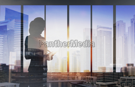 silhouette of businesswoman with tablet pc