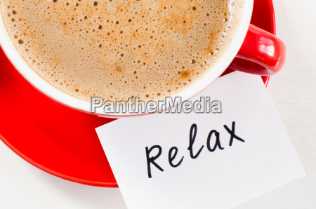 cappuccino mug and notes relax on