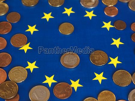 euro coins european union over flag