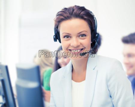 helpline operator with headphones in call