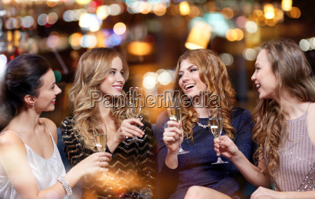 happy women with champagne glasses at