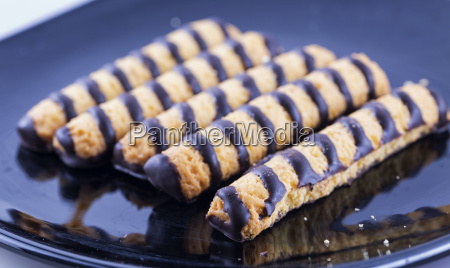 chocolate biscuits over black plate