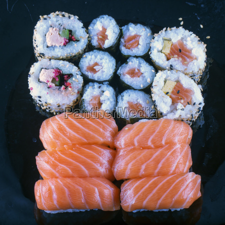sushi over black plate