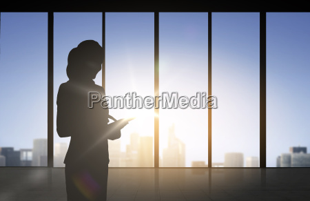 silhouette of business woman with tablet