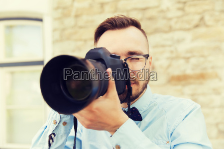 young hipster man with digital camera
