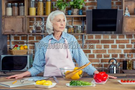 senior woman in apron