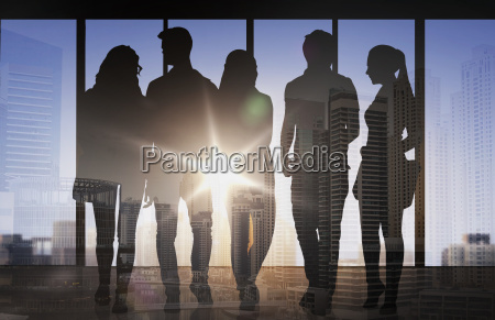 people silhouettes over city airport background