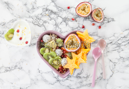 colorful fruit salad in herzschuhessel