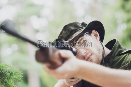 young soldier or hunter with gun