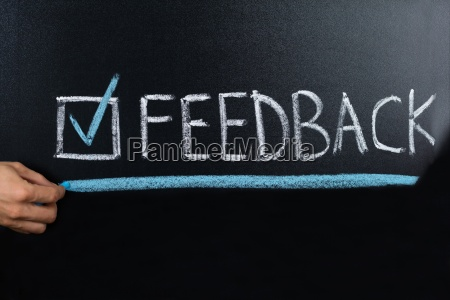 feedback concept written on blackboard