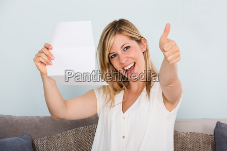 happy woman reading letter