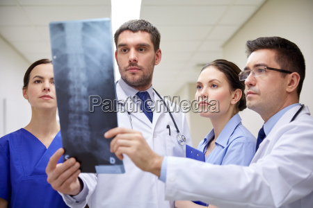 group of doctors looking at x