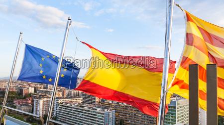 catalan spanish european flags over barcelona