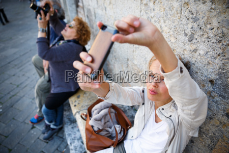 young female tourist using her smart