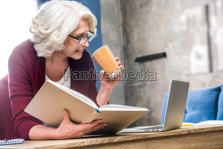 woman holding paper cup