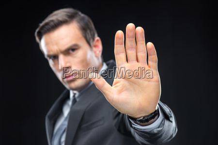 handsome businessman gesturing