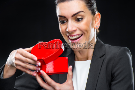businesswoman holding red toy heart