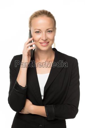 beautiful young caucasian businesswoman using mobile