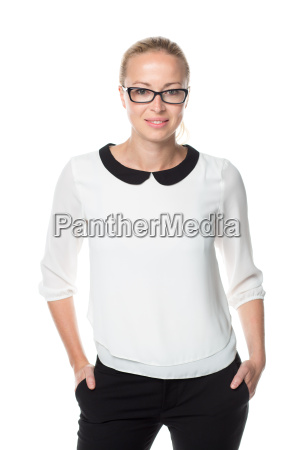 business woman standing arms in pockets