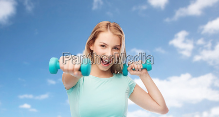 smiling beautiful young sporty woman with