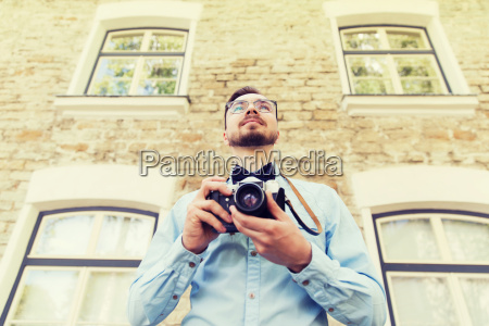 happy young hipster man with film