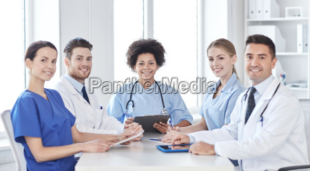 group of happy doctors meeting at