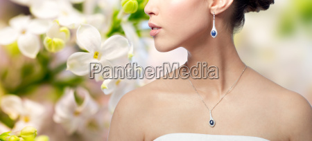 close up of woman with earring