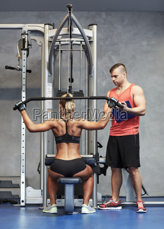 man and woman flexing muscles on