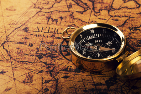 old compass on vintage world map